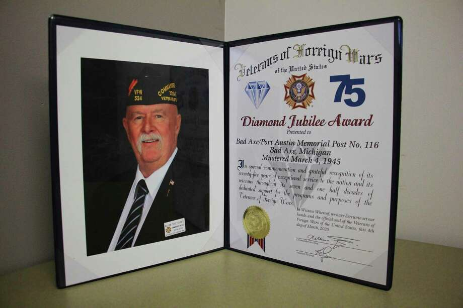 "National Commander of the Veterans of Foreign Wars William ""Doc"" Schmitz congratulates the Bad Axe VFW Post 116 for 75 years of service with the Diamond Jubilee Award. (Sara Eisinger/Huron Daily Tribune)"