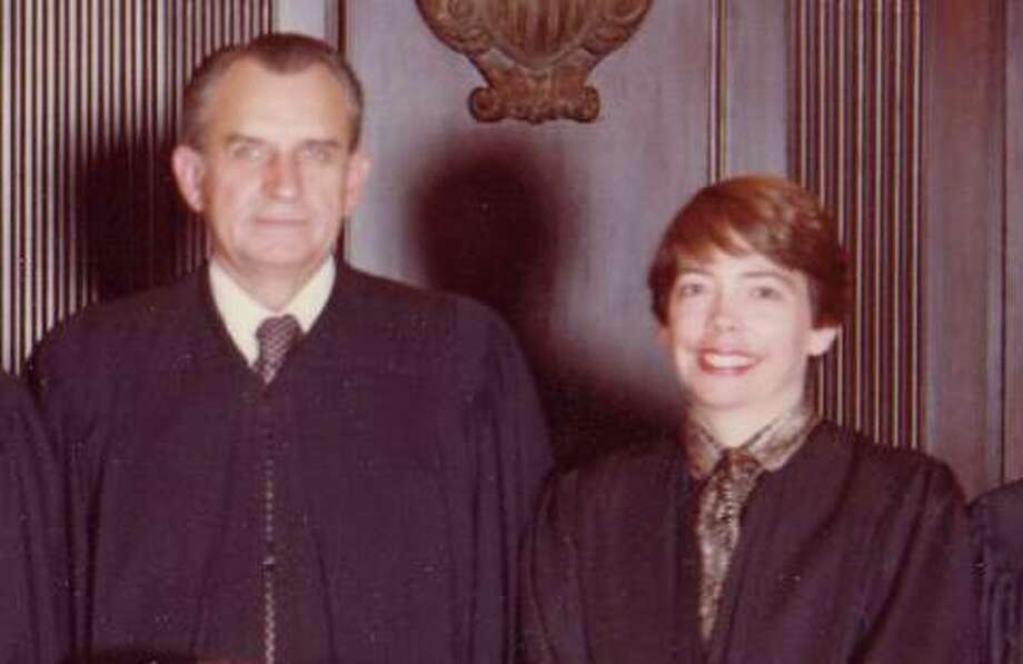 U.S. Judges Thomas M. Reavley and Carolyn Dineen Randall photographed Oct.1, 1981, for their portrait with the 5th U.S. Circuit Court of Appeals. The judges, who were then married to other people, were both appointed to lifetime seats by President Jimmy Carter in 1981. They married in 2004. Photo: Courtesy Carolyn Dineen King / handout