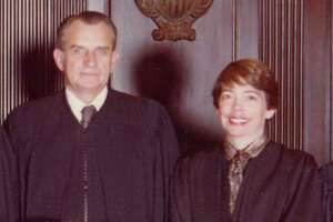 U.S. Judges Thomas M. Reavley and Carolyn Dineen Randall photographed Oct.1, 1981, for their portrait with the 5th U.S. Circuit Court of Appeals. The judges, who were then married to other people, were both appointed to lifetime seats by President Jimmy Carter in 1981. They married in 2004.