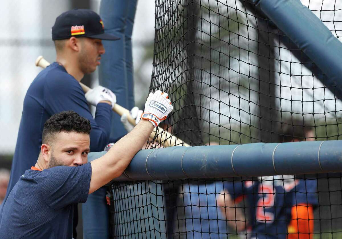 Carlos Correa and Jose Altuve watching batting practice during the first full-squad workout on Monday, took the high road on sign-stealing controversy.