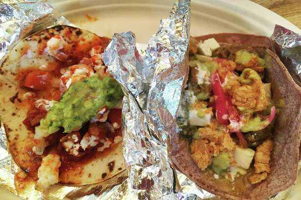 The Riverwalk-O-Taco, left, and the Fiesta Fuego at SayTown Tacos are two of three options currently on the limited menu.