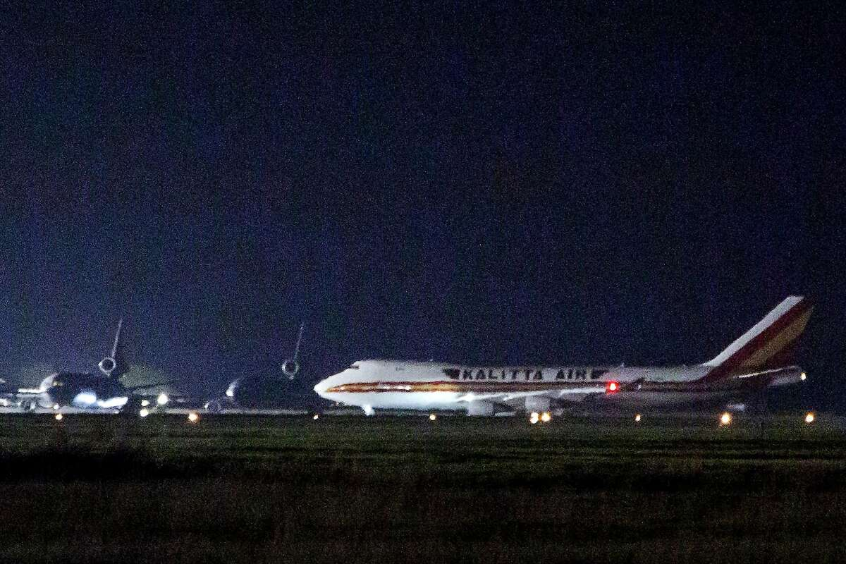 A plane carrying American passengers, who were recently released from the Diamond Princess cruise ship in Japan, arrives at Travis Air Force Base in California on February 16, 2020. - The charter flight touched down at the base 40 miles (70 kilometers) northeast of San Francisco, an AFP photographer saw. The passengers will be quarantined at the base for 14 days. (Photo by Brittany Hosea-Small / AFP) (Photo by BRITTANY HOSEA-SMALL/AFP via Getty Images)