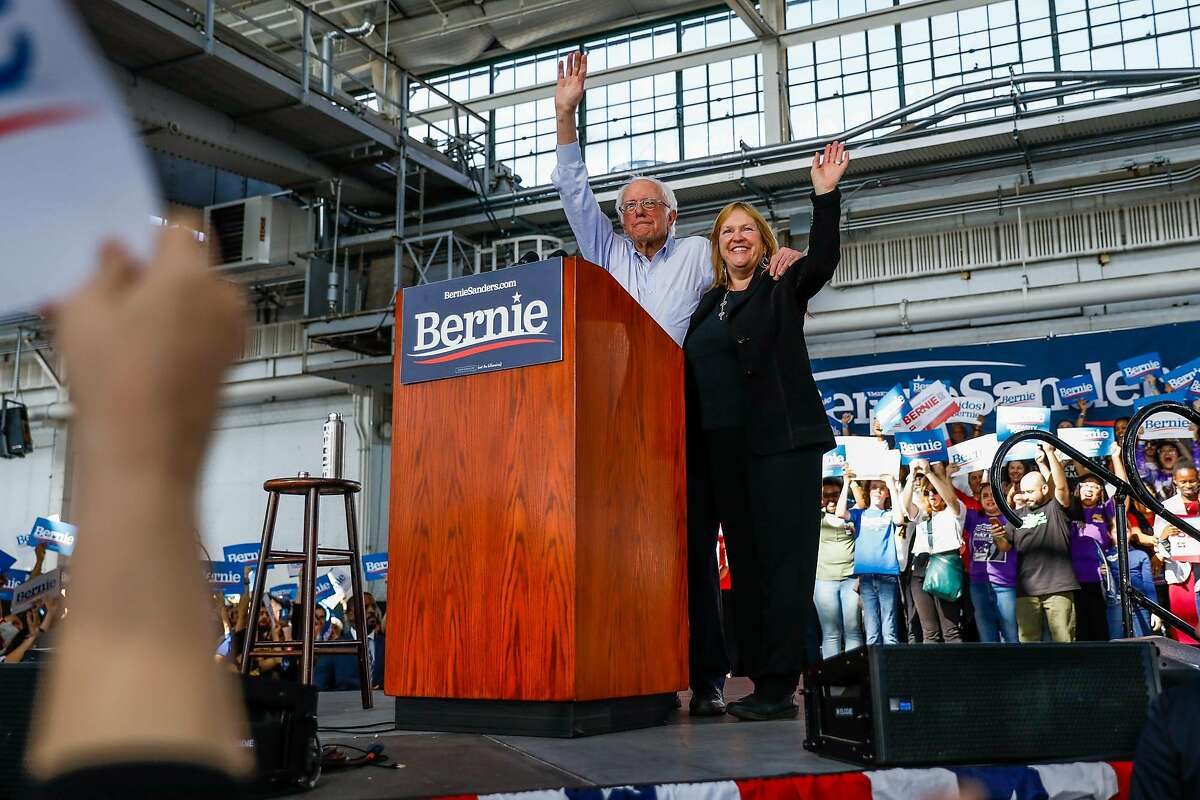 Sen. Bernie Sanders and his wife Jane O'Meara Sanders wave to the crowd at the end of his speech at the Craneway Pavilion in Richmond. He is leading in most of the polls going into California's March 3 primary.