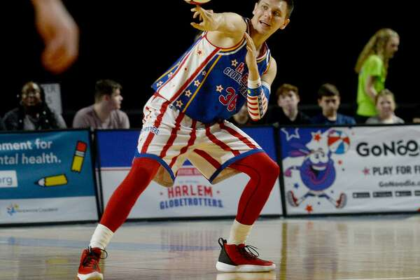 The Harlem Globetrotters wow the crowd with their fancy footwork and signature ball-handling during Monday's show at Ford Park. The event, in which they took on rival The Generals is part of the Globetrotters' 2020 World Tour : Pushing the Limits. Photo taken Monday, February 17, 2020 Kim Brent/The Enterprise