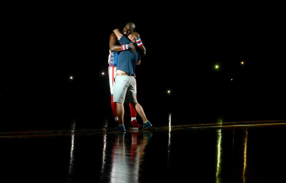 Harlem Globetrotters' Big Easy takes an audience member for a spin on the basketball-turned-dance floor amid cell phone lighting from the crowd during Monday's show at Ford Park. The event, in which they took on rival The Generals, is part of the Globetrotters' 2020 World Tour : Pushing the Limits. Photo taken Monday, February 17, 2020 Kim Brent/The Enterprise Photo: Kim Brent/The Enterprise