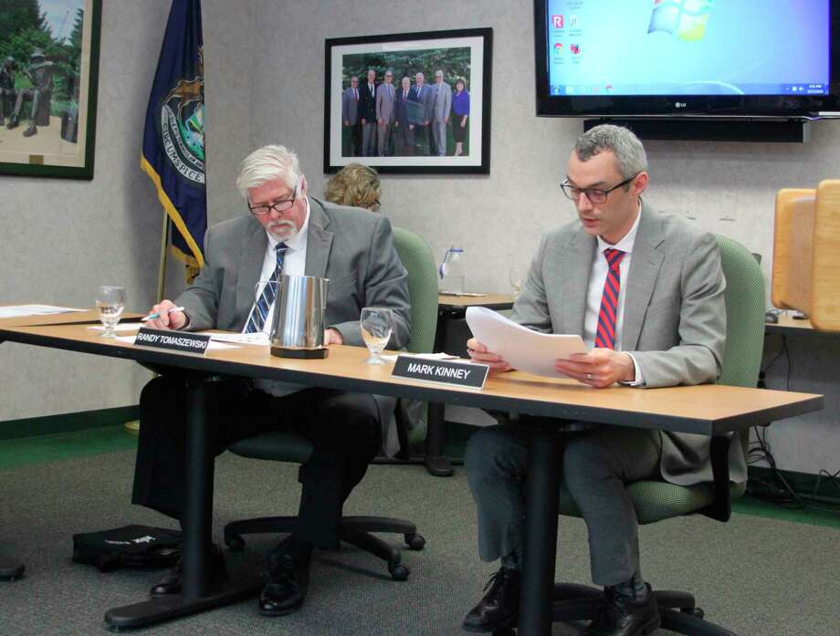 West Shore Community College vice president of Academics and Student Services Dr. Mark Kinney (right) tells the board of trustees about enrollment increases for the winter semester as trustee Randy Tomaszewski (left) and other board members listen. (Ken Grabowski/News Advocate)