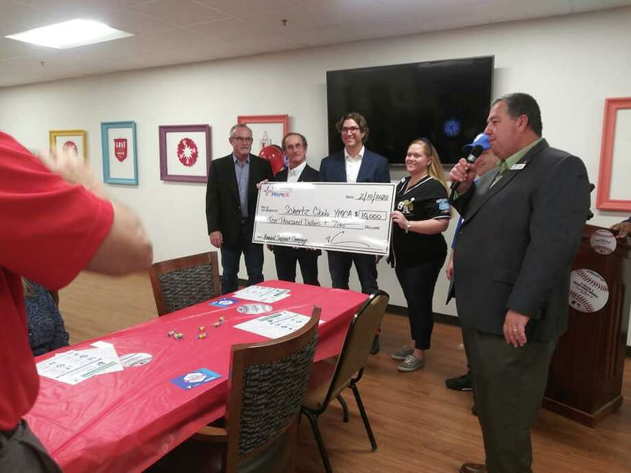 Fredy Degollado, YMCA district vice president, right, announces a $10,000 donation from Physicians Premier Emergency Room that will be used to purchase spring soccer jerseys. Photo: Courtesy Photo /