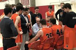 Ridgefield boys basketball coach Andrew McClellan addresses his team during the closing minutes of the Tigers game against Greenwich on Friday, January 3, 2020, in Greenwich.