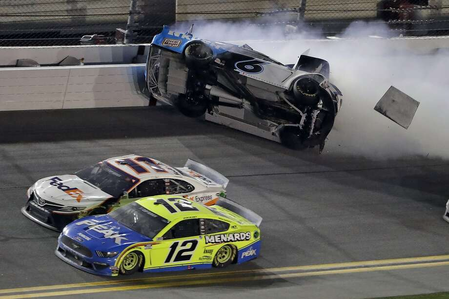 Ryan Newman (6) crashes as Denny Hamlin (11) and Ryan Blaney (12) battle during the NASCAR Daytona 500 auto race Monday, Feb. 17, 2020, at Daytona International Speedway in Daytona Beach, Fla. (AP Photo/Chris O'Meara) Photo: Chris O'Meara, Associated Press