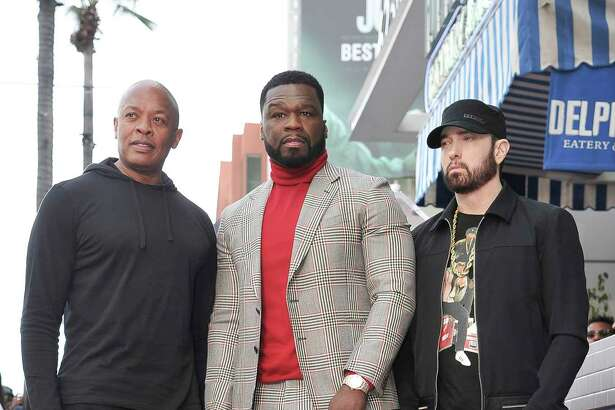 """Dr. Dre, from left, Curtis """"50 cent"""" Jackson and Eminem attend a ceremony honoring Jackson with a star on the Hollywood Walk of Fame on Thursday, Jan. 30, 2020, in Los Angeles. (Photo by Richard Shotwell/Invision/AP)"""