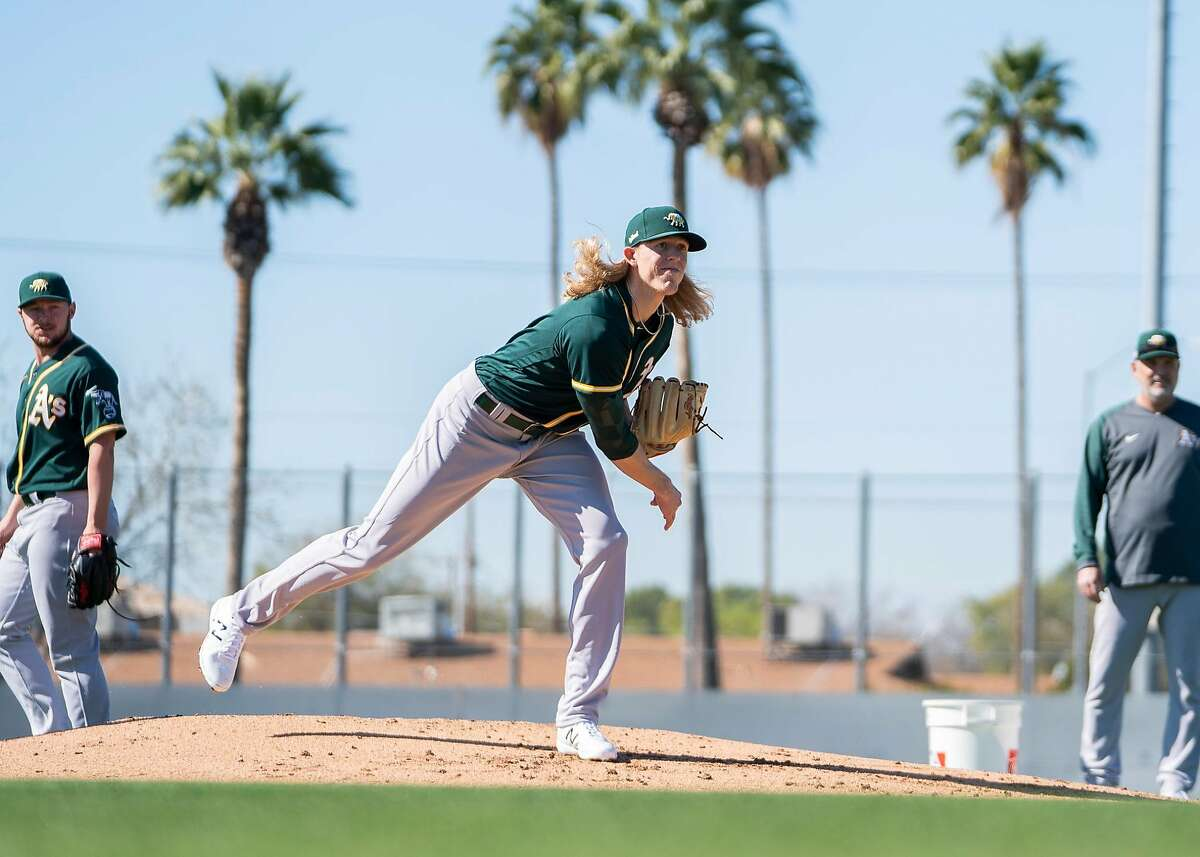 Jordan Weems, a converted catcher, is in Oakland's spring camp as a non-roster pitcher.