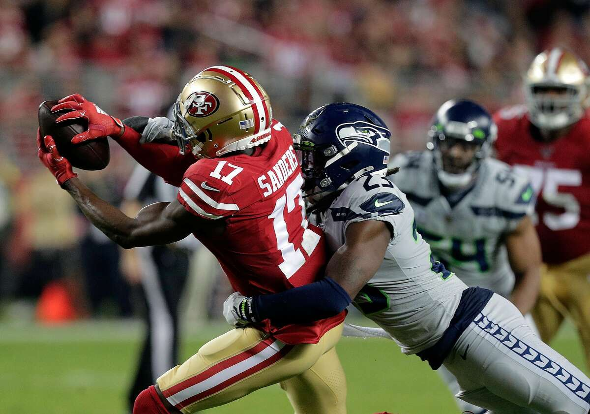 Emmanuel Sanders (17) makes a catch defended by Neiko Thorpe (23) in the first half as the San Francisco 49ers played the Seattle Seahawks at Levi�s Stadium in Santa Clara, Calif., on Monday, November 11/11/19, 2019.