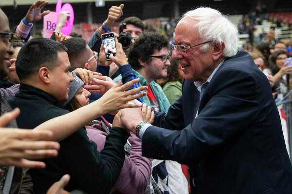 Democratic presidential candidate U.S. Sen. Bernie Sanders, I-Vt., greets supporters during a rally at the Mesquite Arena, Friday, Feb. 14, 2020, in Mesquite, Texas. (Juan Figueroa/The Dallas Morning News via AP)
