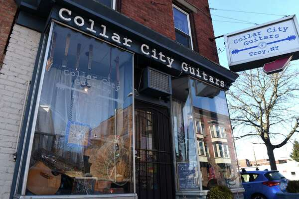 A bullet hole is visible in the Fourth Street front window of Collar City Guitars on Monday, Feb. 17, 2020, in Troy, N.Y. (Will Waldron/Times Union)