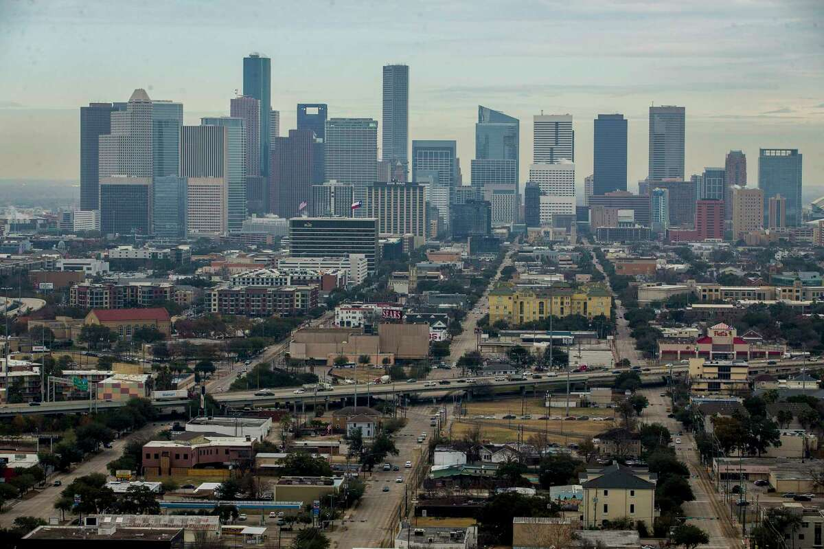 """Midtown is seen from the south looking downtown from the Warwick Tower, Friday, Jan. 19, 2018, in Houston. The area, centered around the Sears building, is being redeveloped as part of an """"innovation corridor"""" stretching from downtown through the medical center."""