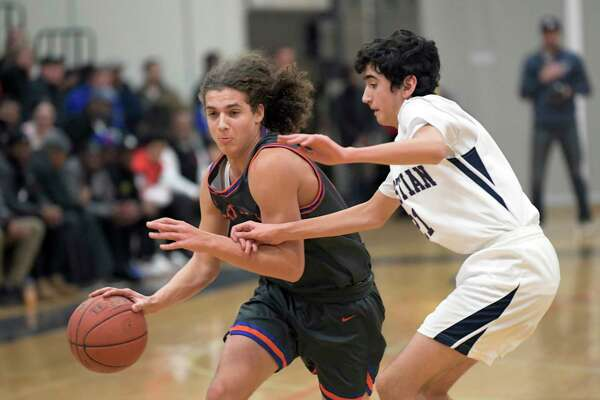 Catskill's Lavon Fernandez (23) moves the ball against Mekeel Christian Academy's Joseph Roddy (21) during a Section II high school basketball game Friday, Dec. 27, 2019, in Rotterdam, N.Y. (Hans Pennink / Special to the Times Union) ORG XMIT: 122819_hsbb1_HP101