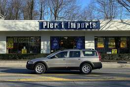 A car passes a Pier 1 Imports store holding a closeout sale, Monday, Feb. 17, 2020, in Larchmont, N.Y. Home goods retailer Pier 1 Imports Inc. is filing for bankruptcy protection. The Fort Worth, Texas-based company, which was founded in 1962, has recently struggled with increased competition from online retailers such as Wayfair. (AP Photo/Julie Jacobson)