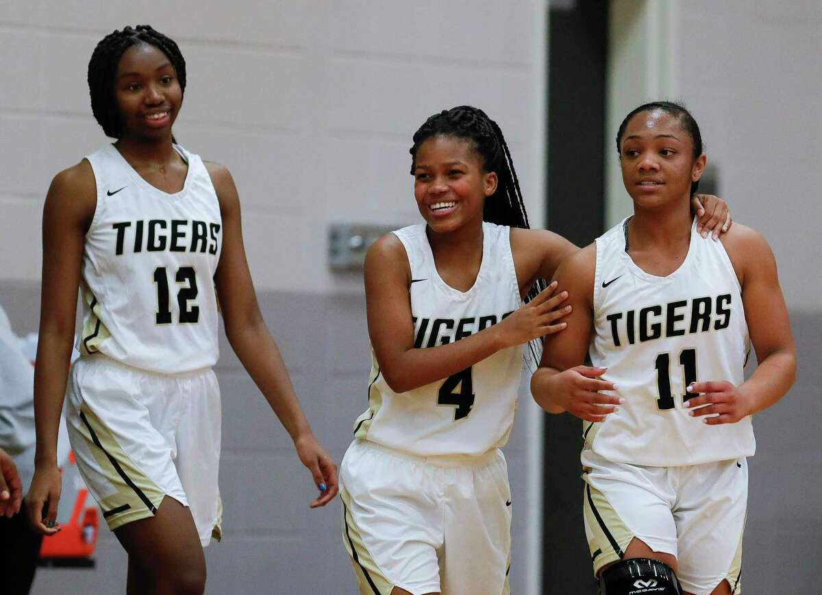 Conroe guard sophomore Tiarra Howard (12), senior Deanna Sneed (4) and sophomore Kennedy Powell (11), shown here earlier this season, played key roles in beating Westfield Monday in the Region II-6A bi-district round at Grand Oaks High School.