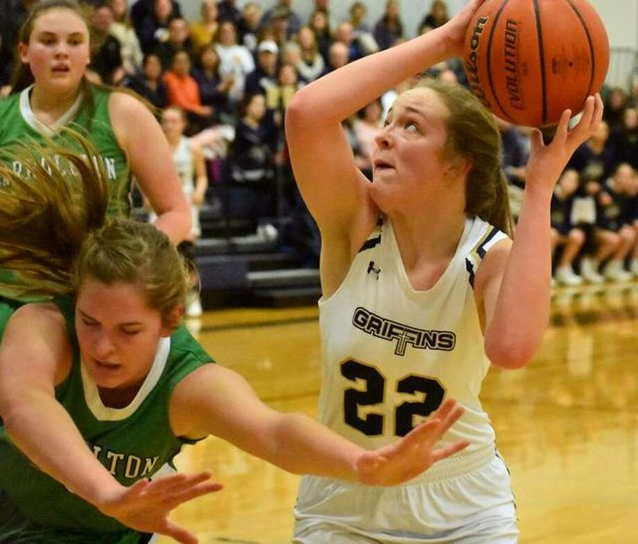 FMCHS forward Charlize Luehmann scores two of her game-high 15 points with a basket late in the fourth quarter against Carrollton in the Class 1A Christ Our Rock Lutheran Sectional semifinals.