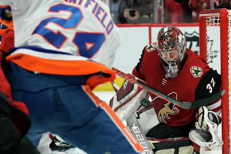Arizona Coyotes goaltender Antti Raanta makes the save on a shot by New York Islanders defenseman Scott Mayfield (24) in the third period during an NHL hockey game, Monday, Feb. 17, 2020, in Glendale, Ariz. Coyotes won 2-1. (AP Photo/Rick Scuteri)