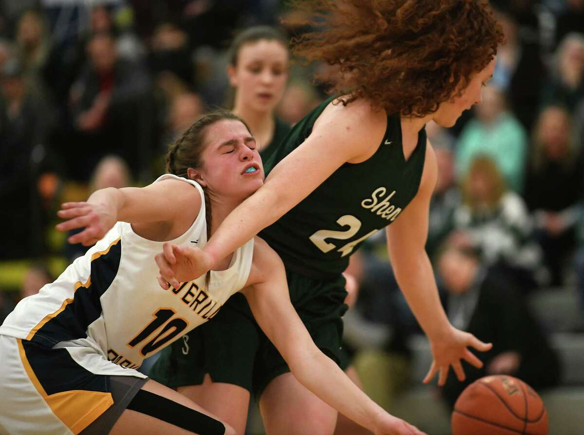Averill Park's Anna Jankovicm left, goes after a rebound against Shenendehowa's Bella Stuart during a game on Monday, Feb. 17, 2020 in Averill Park, N.Y. (Lori Van Buren/Times Union)