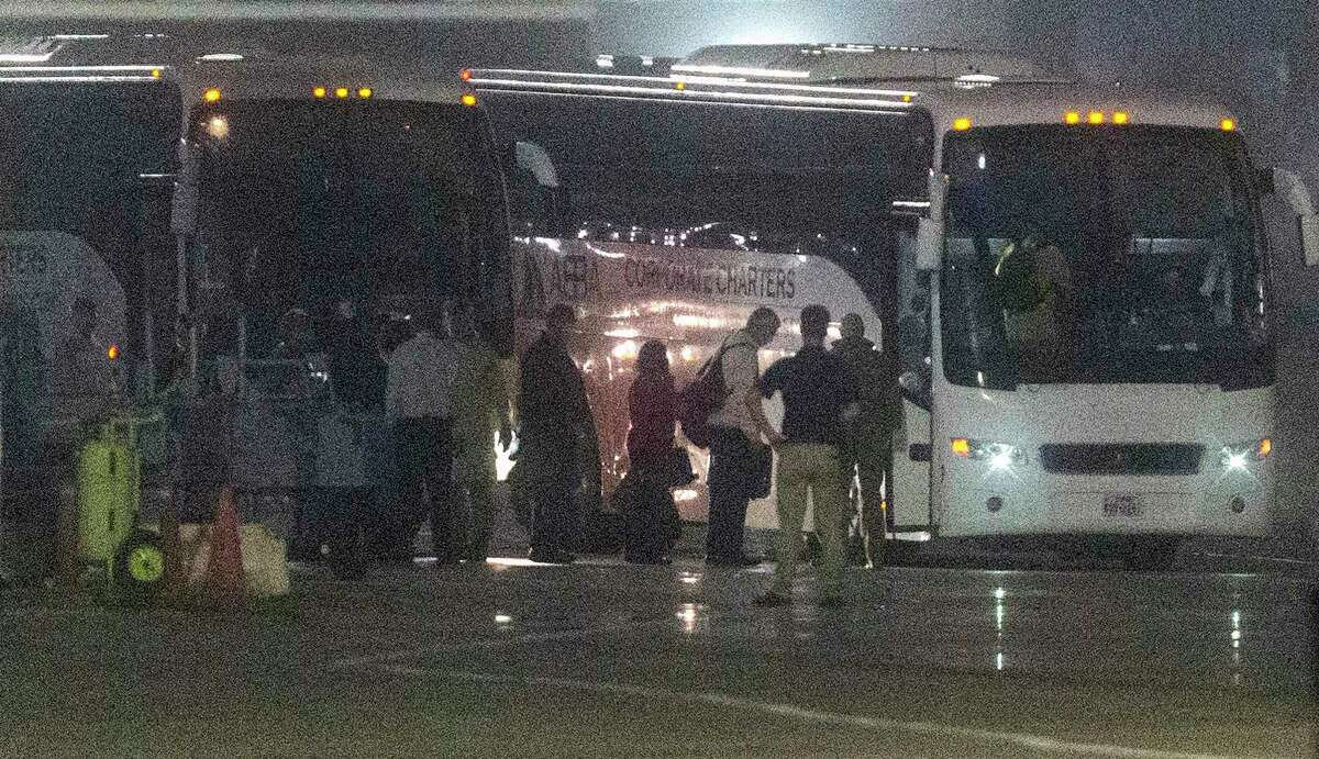 American passengers evacuated from the Diamond Princess cruise ship which has been docked in Japan in quarantine since Feb. 5 get on buses Monday morning, Feb. 17, 2020 after arriving on a Kalitta Air flight at Kelly Field. The former passengers will be quarantined at Joint Base San Antonio-Lackland un til officials can be sure they don't have the coronavirus.