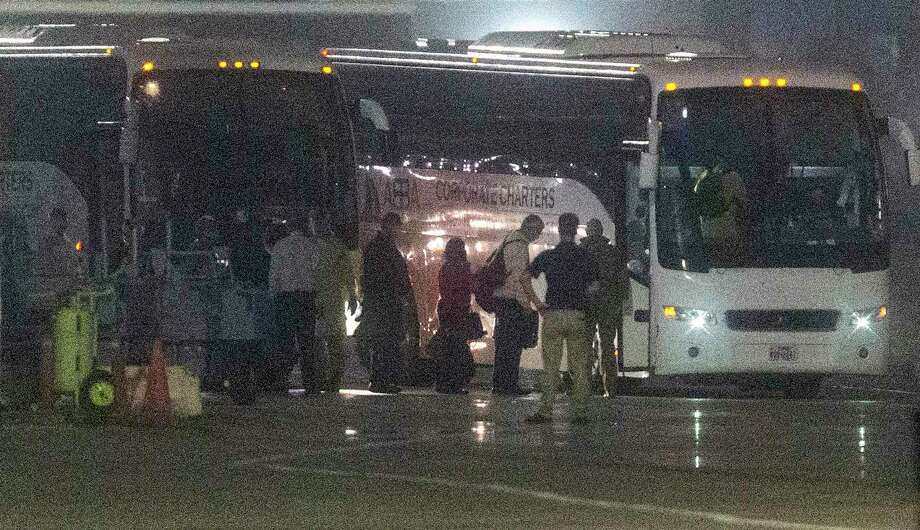 American passengers evacuated from the Diamond Princess cruise ship which has been docked in Japan in quarantine since Feb. 5 get on buses Monday morning, Feb. 17, 2020 after arriving on a Kalitta Air flight at Kelly Field. The former passengers will be quarantined at Joint Base San Antonio-Lackland un til officials can be sure they don't have the coronavirus. Photo: William Luther /Staff Photographer / ©2020 San Antonio Express-News