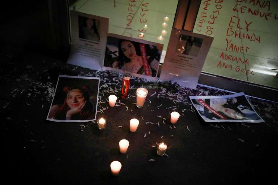 Fotos de mujeres asesinadas colocadas afuera de las oficinas de la policía durante una protesta por los feminicidios en el país, en Tijuana, México, el sábado 15 de febrero de 2020. Photo: Emilio Espejel /Associated Press / Copyright 2019 The Associated Press. All rights reserved