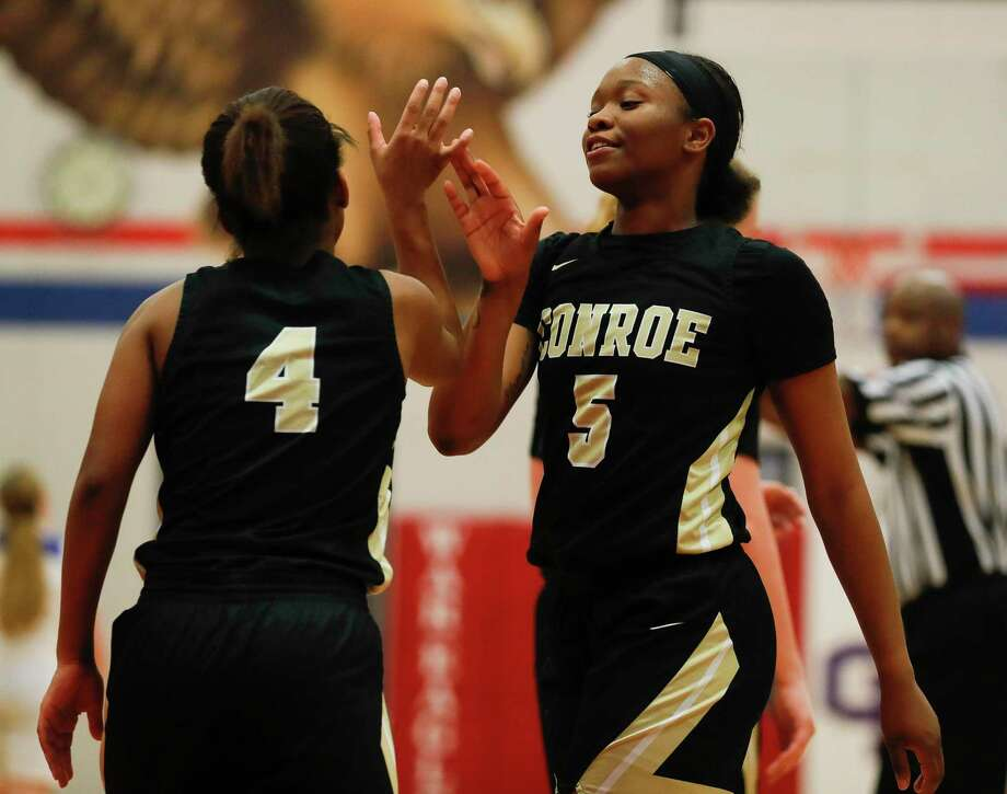 Conroe's Deanna Sneed (4) and JaKayla Bradford are on their way to the next round of the playoffs. Photo: Jason Fochtman, Houston Chronicle / Staff Photographer / Houston Chronicle © 2020