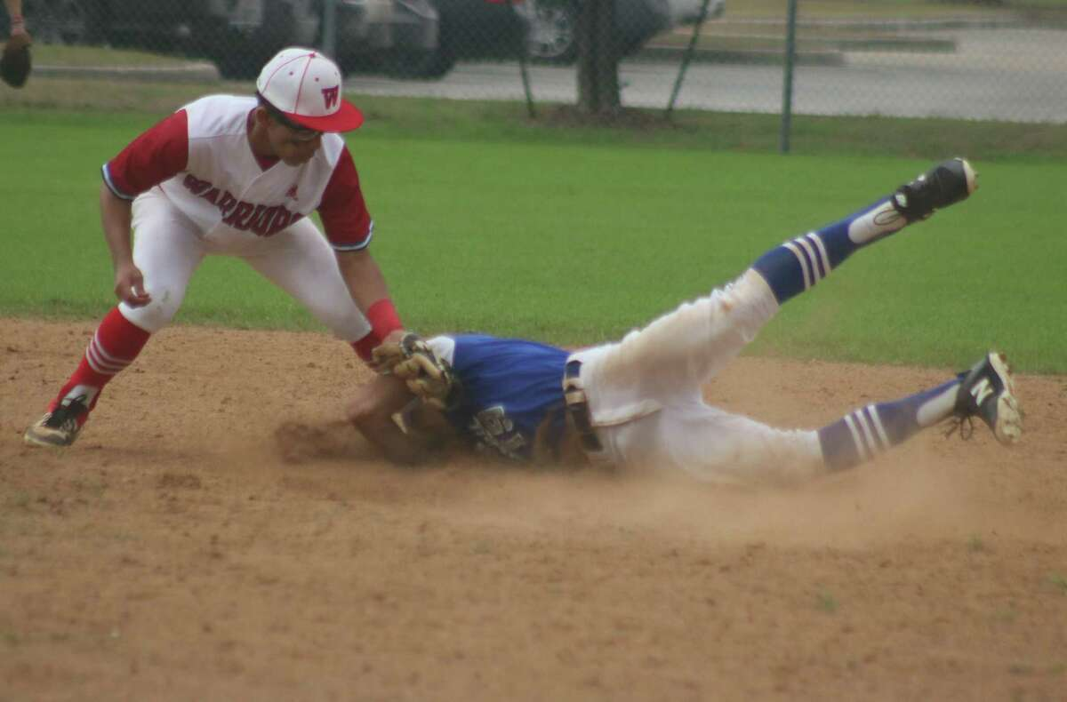 FBCA second baseman Manny Martinez applies the tag on a Frassati Falcon attempting to steal second base in the fourth inning Monday.