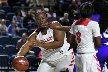 Bellaire senior center Jinaye Pittman, left, starts a fast break against Jersey Village during the 4th quarter of their Region III-6A UIL Girls Basketball Bi-District playoff matchup at Delmar Fieldhouse in Houston on Feb. 17, 2020.