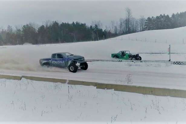 Drag racers kick up snow during this year's 39th annual Dog Party, held at Twisted Trails Offroad Park in Copemish. (Courtesy Photo/Donna Humphrey)