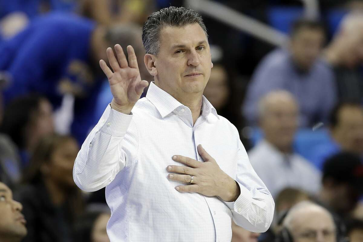 Washington State coach Kyle Smith signals during the second half of the team's NCAA college basketball game against UCLA on Thursday, Feb. 13, 2020, in Los Angeles. (AP Photo/Marcio Jose Sanchez)