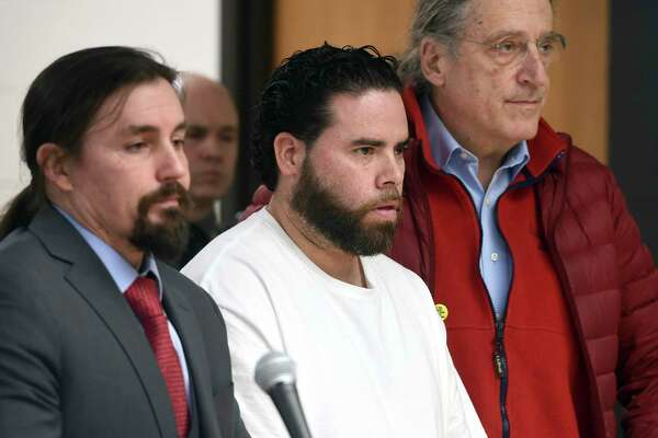 Jose Morales, center, appears for a bond hearing following charges of murder and tampering with physical evidence for the homicide of Christine Holloway with attorneys Kevin Smith, left, and Norm Pattis at Derby Superior Courthouse in Derby, Connecticut, on Friday, Feb. 7, 2020. (Arnold Gold/New Haven Register via AP)
