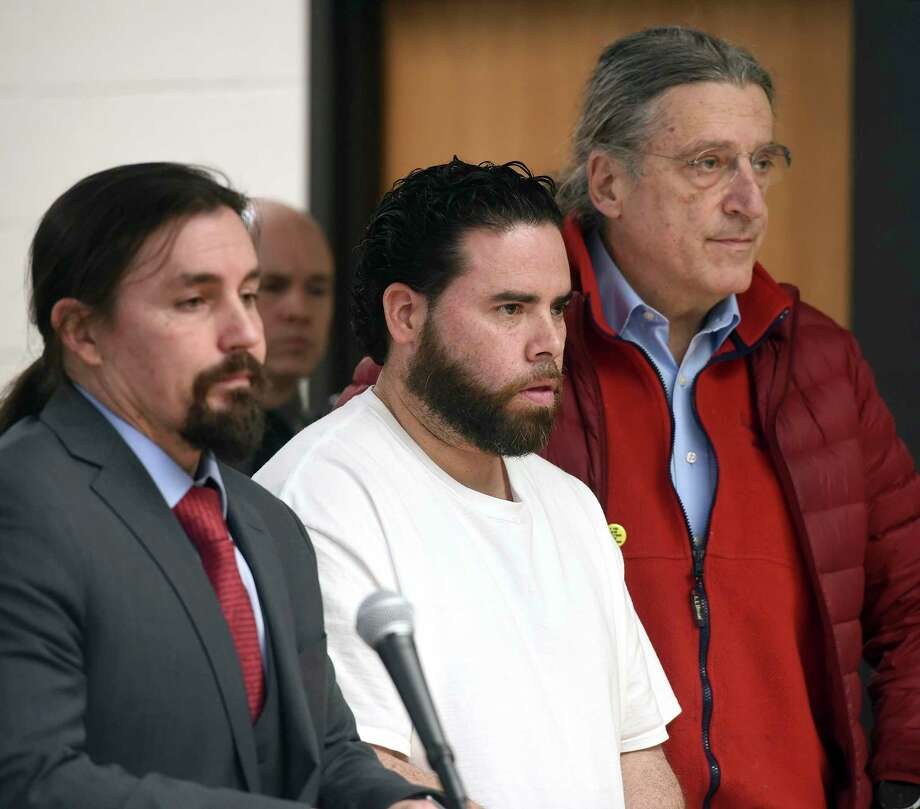 Jose Morales, center, appears for a bond hearing following charges of murder and tampering with physical evidence for the homicide of Christine Holloway with attorneys Kevin Smith, left, and Norm Pattis at Derby Superior Courthouse in Derby, Connecticut, on Friday, Feb. 7, 2020. (Arnold Gold/New Haven Register via AP) Photo: Arnold Gold / Associated Press / New Haven Register
