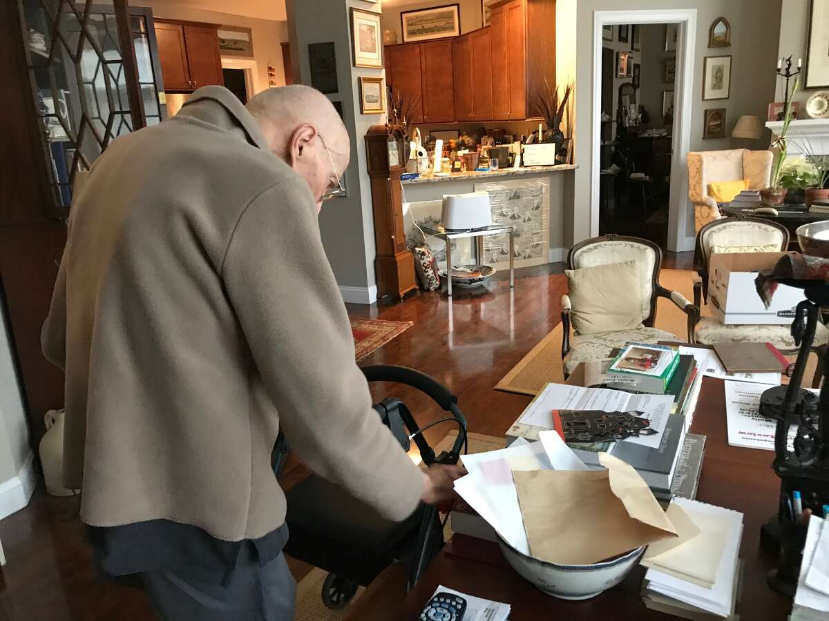 Norman Rice looks over some archival material from his long career as a collector and director of the Albany Institute of History & Art.