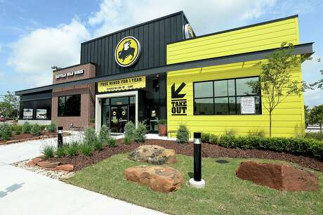 Beaumont's new Buffalo Wild Wings on Dowlen Road near Parkdale Mall will open Sunday. The spacious popular eatery features the signature banks of televisions and a patio dining/bar area. Mayor Becky Ames met with the owner and corporate officials for a ribbon cutting and preview of the interior Thursday. Photo taken Wednesday, April 22, 2015 Kim Brent/The Enterprise