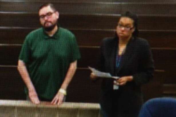 HISD teacher James Bradley, left, who is accused of molesting a student, appears before a magistrate on Monday, Feb. 17, 2020.