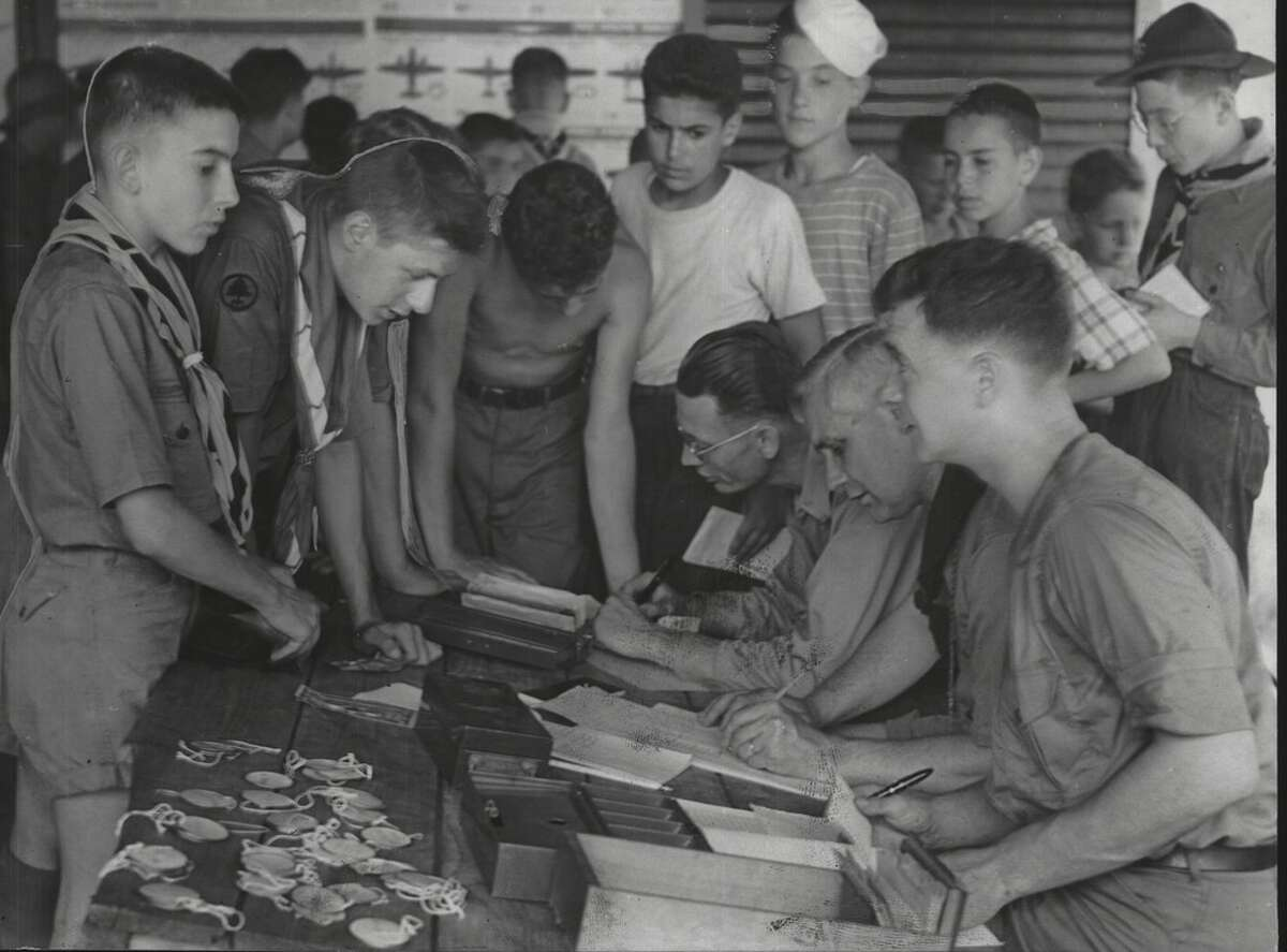 Some of the members of Fort Orange Council Boy Scouts, among the first group to attend this year's sessions at Camp Hawley on Kinderhook Lake, are shown registering with Scout officials in 1943.