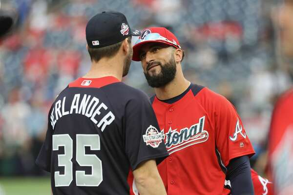 WASHINGTON, DC - JULY 16: Nick Markakis #22 of the Atlanta Braves and the National League speaks to Justin Verlander #35 of the Houston Astros and the American League during Gatorade All-Star Workout Day at Nationals Park on July 16, 2018 in Washington, DC. (Photo by Rob Carr/Getty Images)