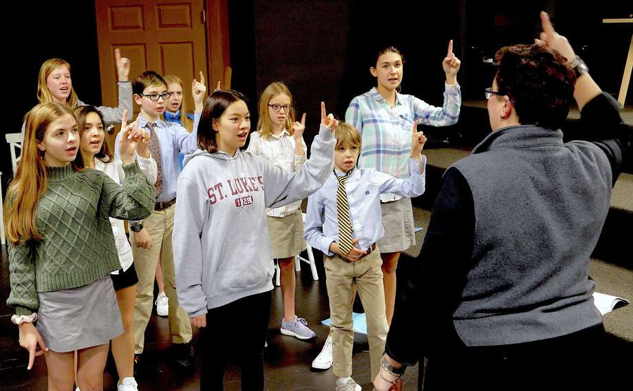 """St. Luke's Middle School students rehearse for the winter musical, """"Curtains."""" at the school in New Canaan: Ali DeFilippo '25 (Bedford); Ella Sato-Connell '24 (Fairfield); Jack Aronian '27 (North Salem); director Magistra Mahler; Row 2: Sally Picon '24 (Norwalk); Rylan James '27 (Bethel); Ella Thomas '25 (New Canaan); Reese Kubick '25 (Ridgefield); Row 3: Amanda Martin '26 (Darien); Juliet Geraci '25 (Stamford). Photo: Valerie Parker"""