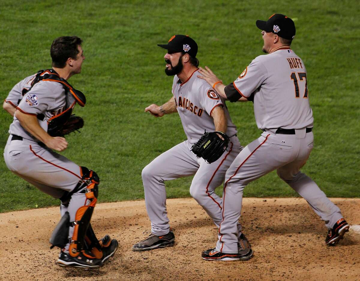 San Francisco Giants Brian Wilson celebrates with Buster Posey, left and Aubrey Huff, right after winning the World Series in Game 5 of baseball's World Series against the Texas Rangers Monday, Nov. 1, 2010, in Arlington, Texas. The Giants won 3-1 to capture the series.