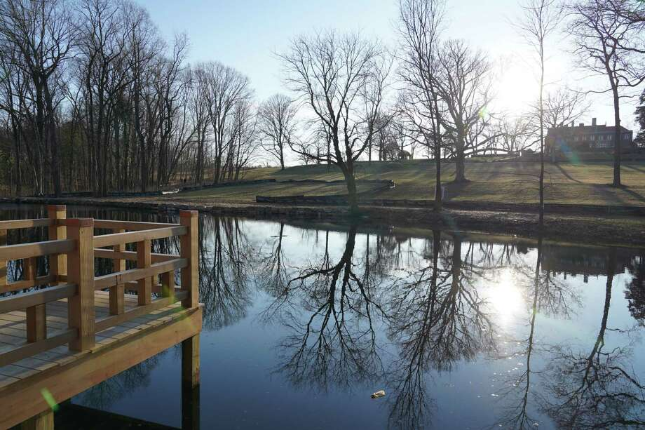 The Waveny Park Conservancy is undertaking $350,000 in renovations at Anderson Pond in New Canaan with money donated by the Harlan and Lois Anderson Family Foundation. A trail has been blazed and bridges built to allow visitors to circumnavigate the water body. A viewing platform has been constructed for visitors to walk out over the pond. Photo: Grace Duffield / Hearst Connecticut Media