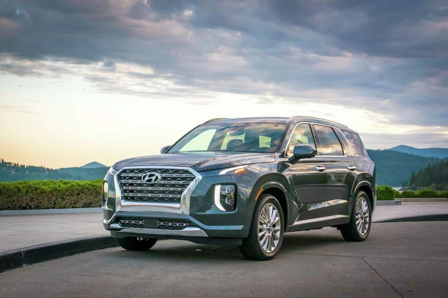 The 2020 Hyundai Palisade is a medium-priced SUV that can transport seven or eight passengers, depending on the configuration of the second-row seating. It boasts an impressive 18 cubic feet of luggage space behind the third-row seat, and is powered by a 291-horsepower V-6 engine. Photo: Hyundai Pressroom / Contributed Photo