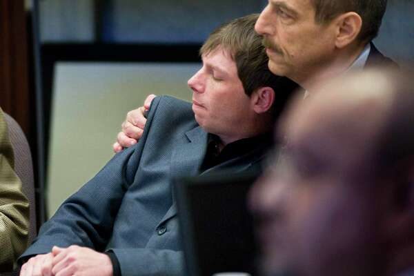 """FILE - In this April 13, 2010 file photo, Kerry Lewis, left, leans into his lawyer Paul Mones after the verdict against the Boy Scouts of America was announced in a sexual abuse case in Portland, Ore. The Boy Scouts of America has filed for bankruptcy protection as it faces a barrage of new sex-abuse lawsuits. The filing Tuesday, Feb. 18, 2020, in Wilmington, Del., is an attempt to work out a potentially mammoth compensation plan for abuse victims that will allow the 110-year-old organization to carry on. """"There are a lot of very angry, resentful men out there who will not allow the Boy Scouts to get away without saying what all their assets are,"""" said lawyer Paul Mones, who represents numerous clients suing the BSA. """"They want no stone unturned."""" (Jamie Francis/The Oregonian via AP, File)"""