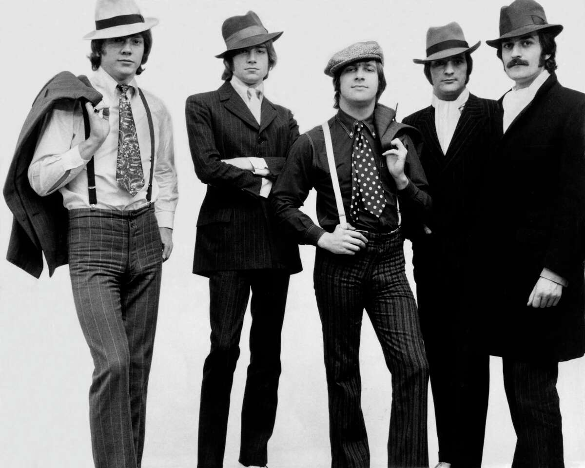 The Moody Blues dressed like gangsters for a photo shoot in 1967. From left are John Lodge, bass; Justin Hayward, lead guitar and singer; Graham Edge, drums; Mike Pinder, melophone; and Ray Thomas, flute.