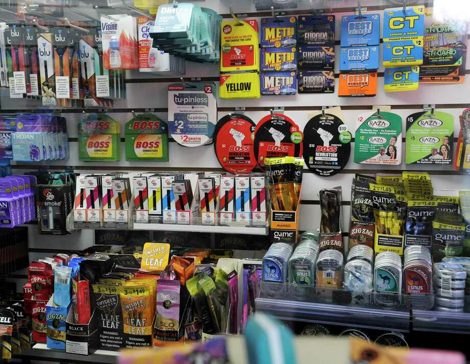 A display at Stamford Photo and News on Jan, 8, 2020 in Stamford, Conn., is filled with an assortment of products, including e-vaping and tobacco products, that the retailer offers for sale. Photo: Matthew Brown / Hearst Connecticut Media / Stamford Advocate