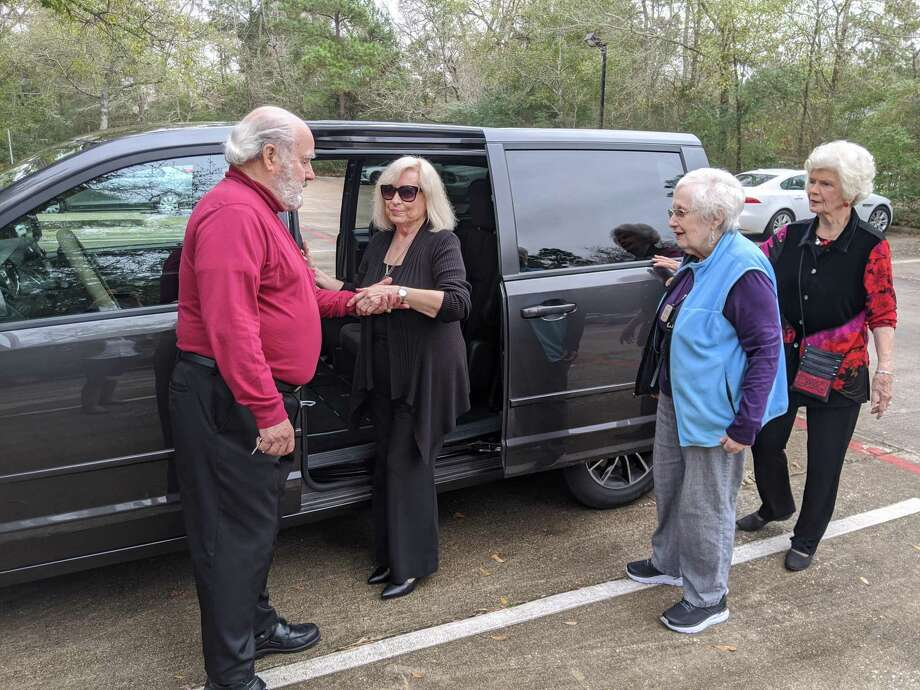 Gerry Saber, left, a volunteer with Aging In Place-The Woodlands, helps Blanca Bradley, a client of the organization, into his van as Beth Kulkarni and Carol Saber wait to load in as well. AIP helps residents of The Woodlands stay social, and gets them where they need to go through volunteer driven rides. Photo: Jamie Swinnerton