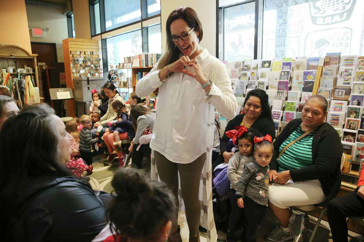 Anastasia McKenna, aka Miss Anastasia, the storyteller at The Twig Bookstore, meets with her young guests before a recent Friday morning story time.