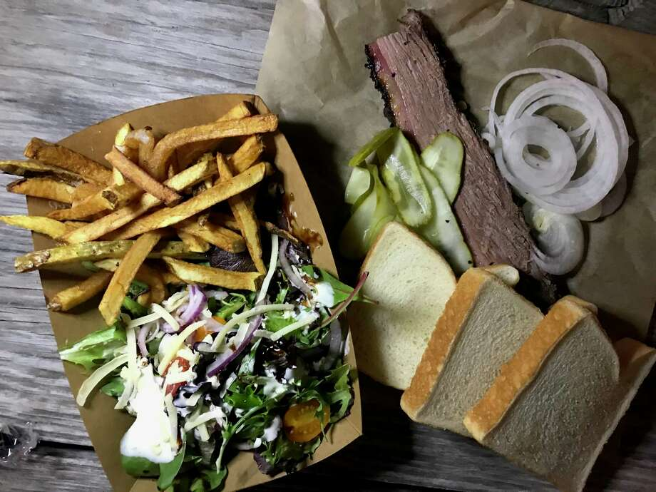 Brisket plate with a salad and fries from Alamo Smoke Photo: Paul Stephen / Staff